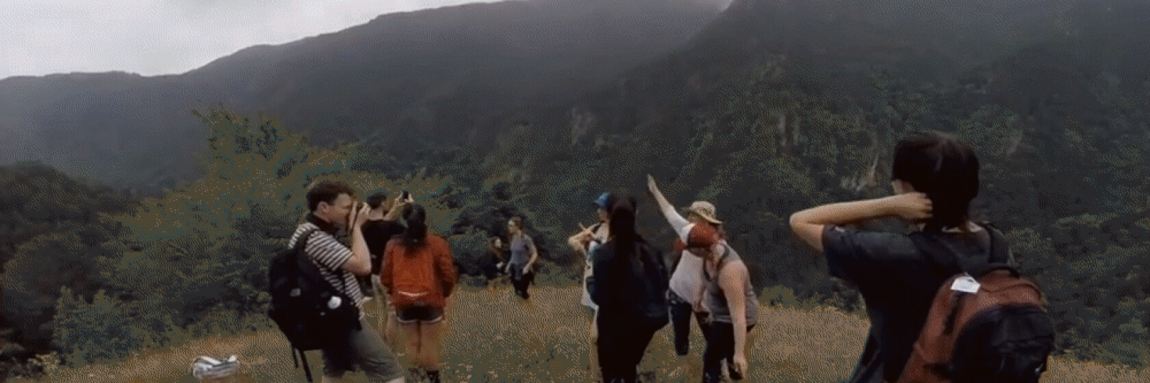 Student group hikes through valley.
