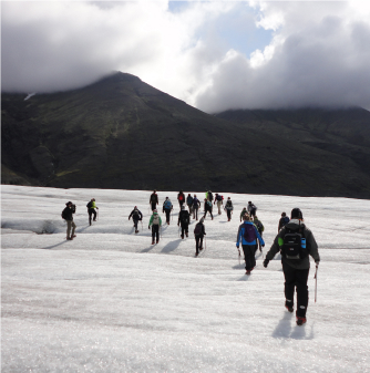 Group hikes across icy landscape.