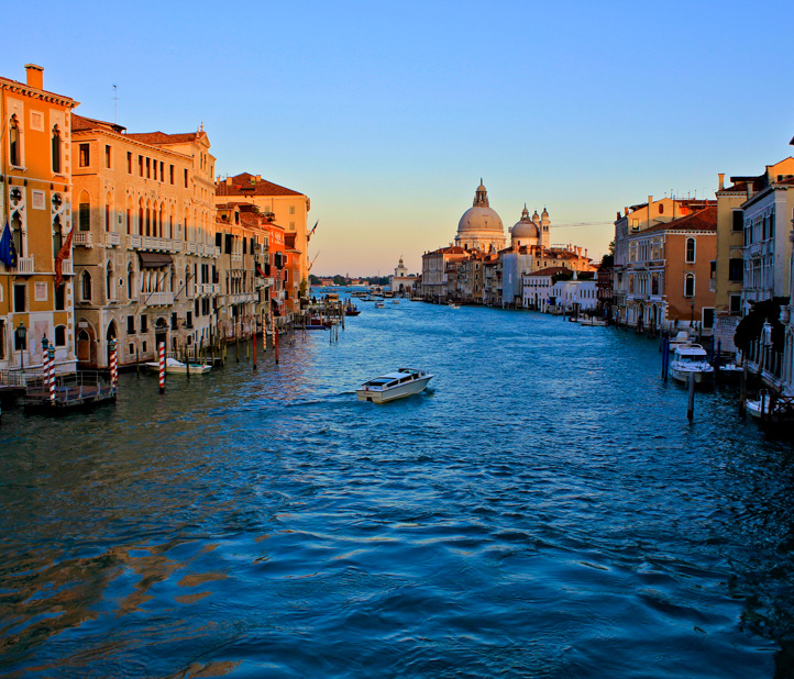 Italian canal at sunset.