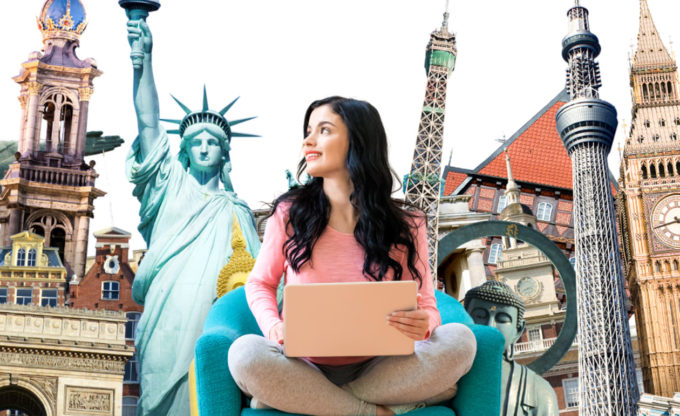 Woman in chair with famous landmarks behind.